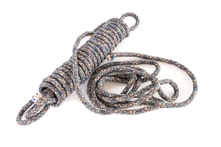 fasten: Twisted thick rope on white. Stock Photo