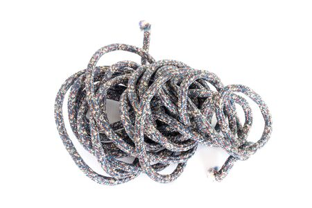 Twisted thick rope on white. Imagens