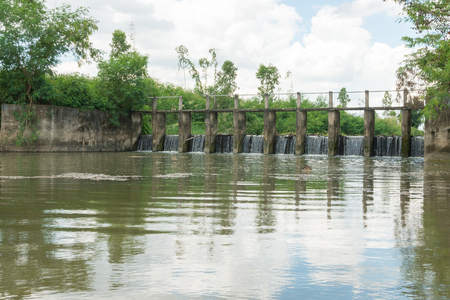 Water being released from a dam,water Overflow the weir. Stock Photo