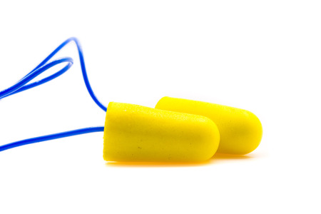 Yellow earplugs with blue band on white background.