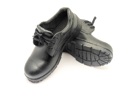 Protective workwear black safety shoes on white background.