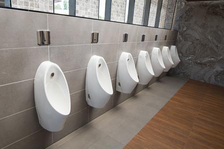 Urinals Men public in toilet room. White urinals ceramic in mens bathroom.