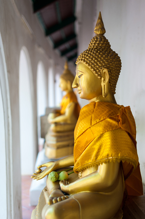 Gold buddha statue. old vintage buddha state, Thailand temple.