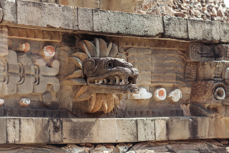 Carving details of Quetzalcoatl Pyramid at Teotihuacan Ruins - Mexico City.