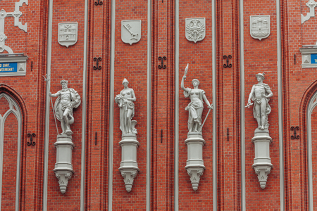 Four sculptures on Blackheads house wall in Riga.