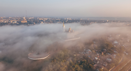 An incredibly beautiful misty morning over Vladimir. Aerial view on Assumption Cathedral in the fog. Russia. Vladimir
