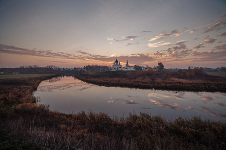 View of the Suzdal Kremlin located on the Kamenka River at sunrise. Golden Ring of Russia