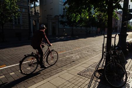 A young cyclist rides along a city street. Vilnius. Lithuania