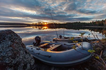 Fishing boats near the lake at sunset.