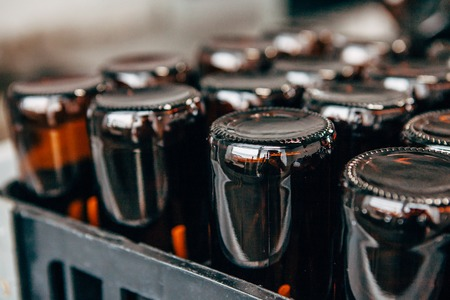 close-up of empty beer bottles upside down in a plastic box Stock Photo