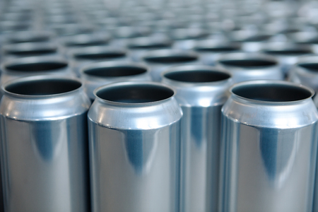 Empty aluminum cans without lids and without etiquette in stock. Close-up