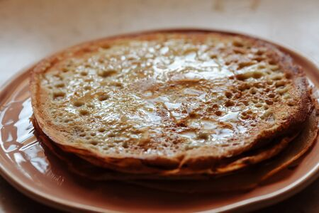 Stack of hot classic Russian thin pancakes. Rustic style. Traditional for the Russian pancake week - Maslenitsa. Close-up. Zdjęcie Seryjne
