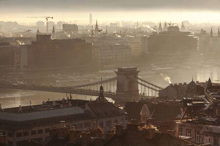 Panorama of Budapest at sunrise. Szechenyi bridge in the autumn morning.
