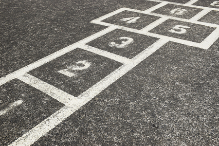 Childrens Hopscotch Game on Concrete in a School Playground
