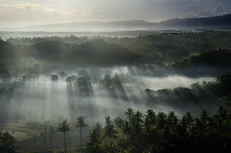 tranquil atmosphere: Smoke at Chocolate Hills in Bohol Stock Photo