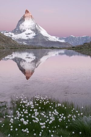 alpenglow: The Mattherhorn reflected on the Riffelsee Lake at Sunrise