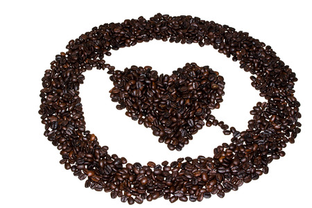 non alcoholic: pictograms and symbols, elements and statements, phrases and messages which are laid out from grain coffee. Issued in a circle on the center on the white isolated background.