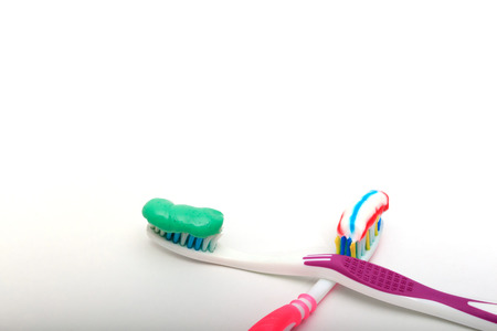 paradontosis: toothbrush with toothpaste on a white background