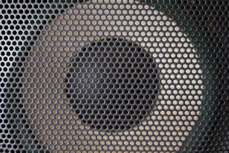 looking straight: Background consisting of a grid and an audio speaker