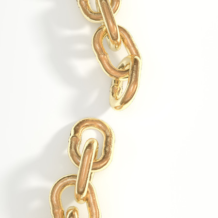 torn piece of gold chain on a white background