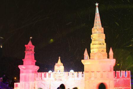 children's show: 01062016 Russia. Moscow, Poklonnaya Gora, Victory Park. The exhibition of ice sculptures Ice Moscow. In the family circle. Ice sculpture of the Moscow Kremlin Spasskaya Tower