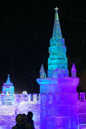 ice sculpture: 01062016 Russia. Moscow, Poklonnaya Gora, Victory Park. The exhibition of ice sculptures Ice Moscow. In the family circle. Ice sculpture of the Moscow Kremlin Spasskaya Tower