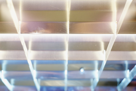 blurred background in the form of square lamps tubes Standard-Bild