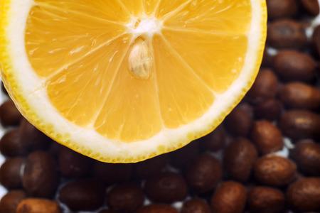Macro Photography of half a lemon on coffee beans.