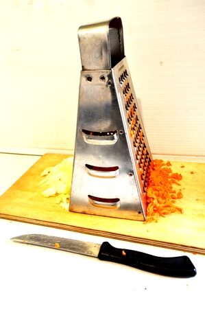 workpiece: image grater with chopped onions and carrots.