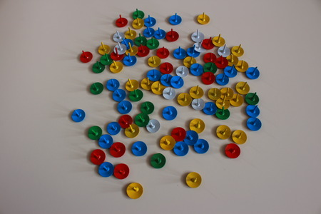 clout: Colorful tacks on white ground.