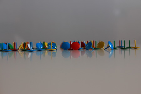 clout: A mess of colorful tacks.