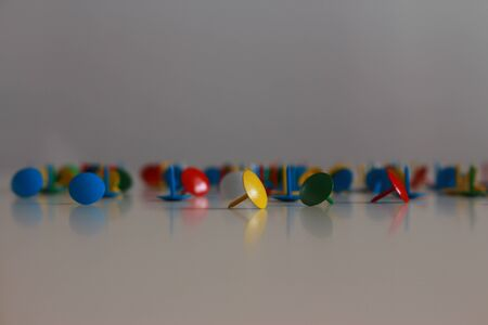 clout: Messy colorful tacks. Stock Photo
