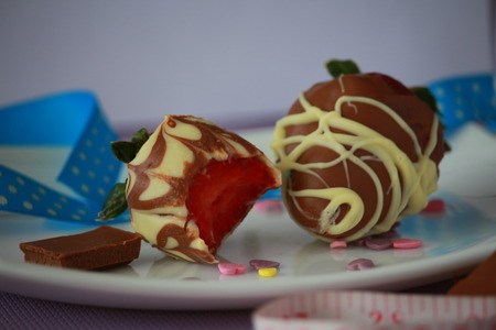 Two very delicious strawberries photo