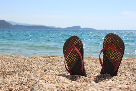 thongs: Thongs on the beach Stock Photo