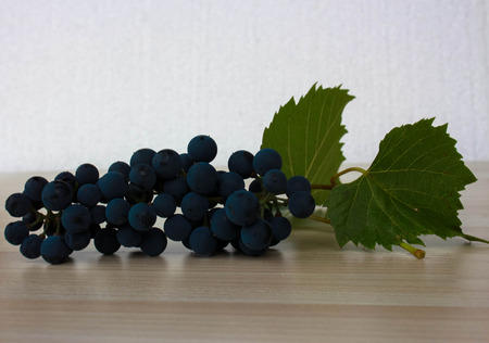 biological vineyard: Raceme of vine grapes in white background