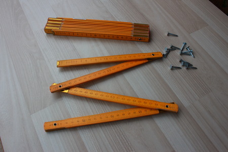nails: Two wooden meters and nails Stock Photo