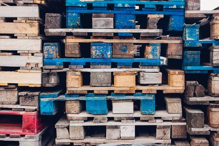 euro pallet: Pile of colorful wooden pallets