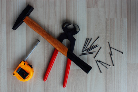 tongs: Hammer, tape, tongs and nails Stock Photo