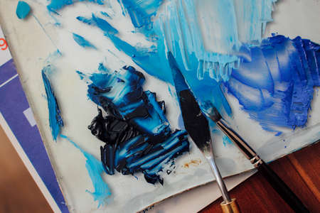 mess: Pallet, brush and mess of blue paints