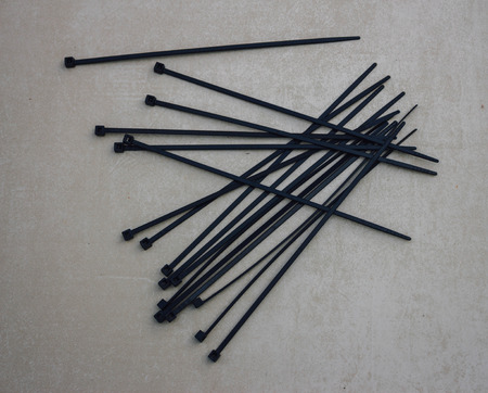 zip tie: Black cable ties Stock Photo