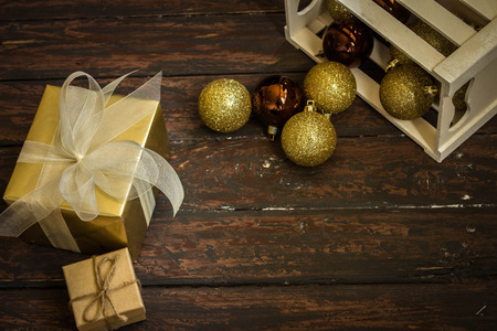 cosiness: Christmas toys and gifts on wooden floor