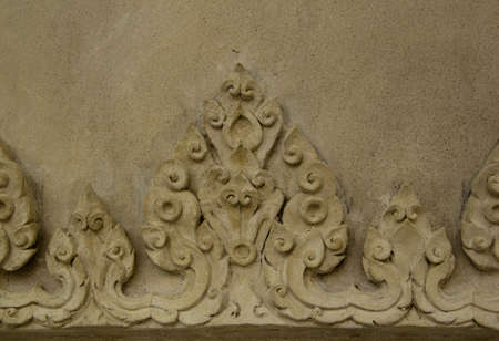stucco facade: a stucco on door facade temple Stock Photo