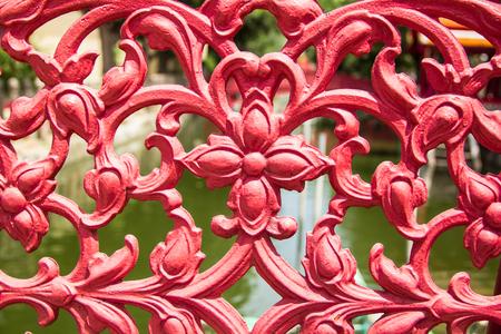 cast iron red: red cast iron on bridge railing Stock Photo