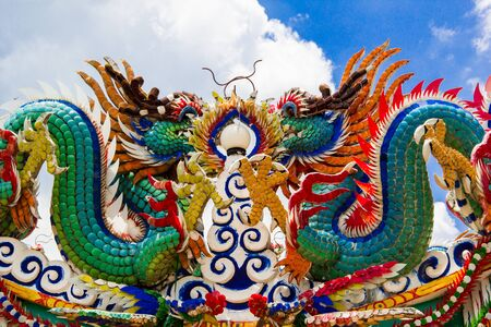 duplex: colorful twin dragon on the chinese temple