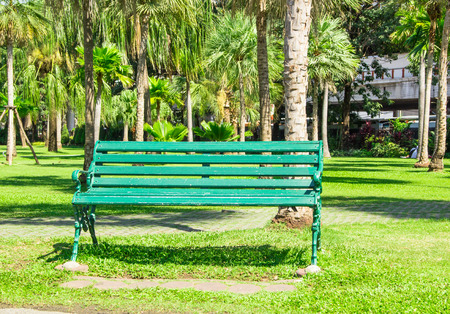 green bench in Jatujak park bangkok thailand Stock Photo