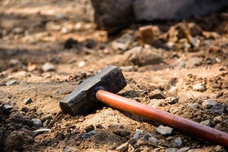 big sledge hammer on construction site Stock Photo
