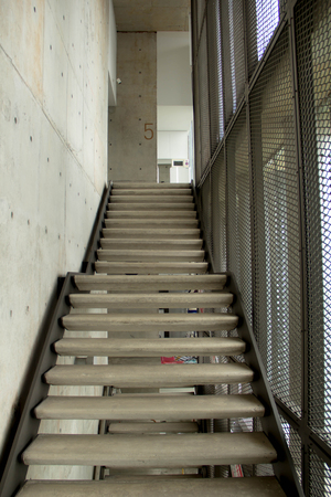 rainforce concrete stair and net partition on building 版權商用圖片
