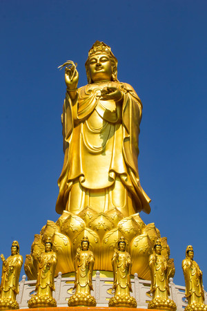 Kuan Yin image of buddha Chinese art on blue sky