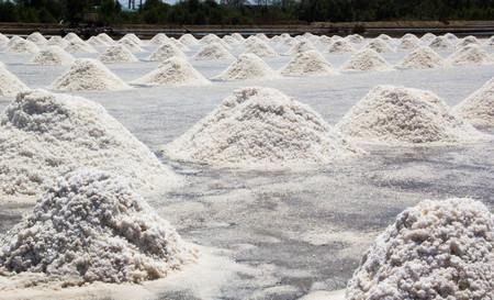 Heap of sea salt in salt farm ready for harvest