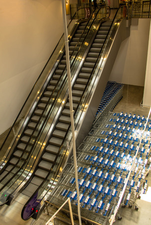 Two moving underground escalator in the shopping mall